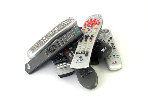 This pile of remotes is now obsolete with DIRECTV Commercial iPad App