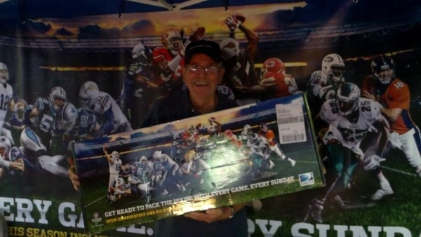 Winner of the NFL Sunday Ticket Marketing kit at the House of Football Fan Appreciation Party