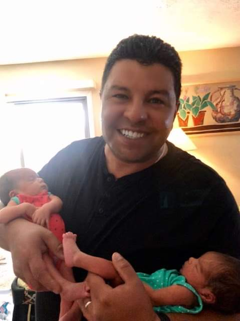 Armando Lopez of Its All About Satellites holding his twin girls